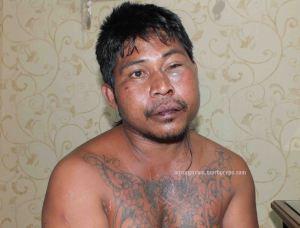 Tersangka perampok dan pembunuh AIJ alias Aco di mapolres Bitung (ardan gala)